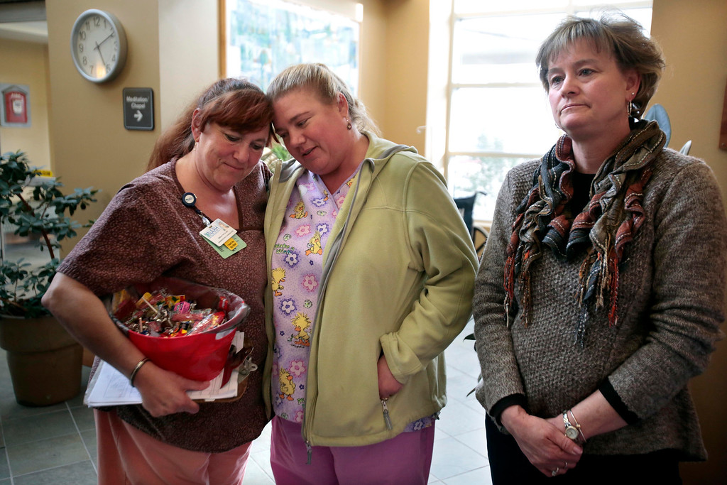 Description of . Nurses Miriam Duval, left, and Karin Robert console each other beside Robbin Simonetti after the sudden announcement of the closure of the North Adams Regional Hospital on Tuesday, March 25, 2014. Stephanie Zollshan / Berkshire Eagle Staff / photos.berkshireeagle.com