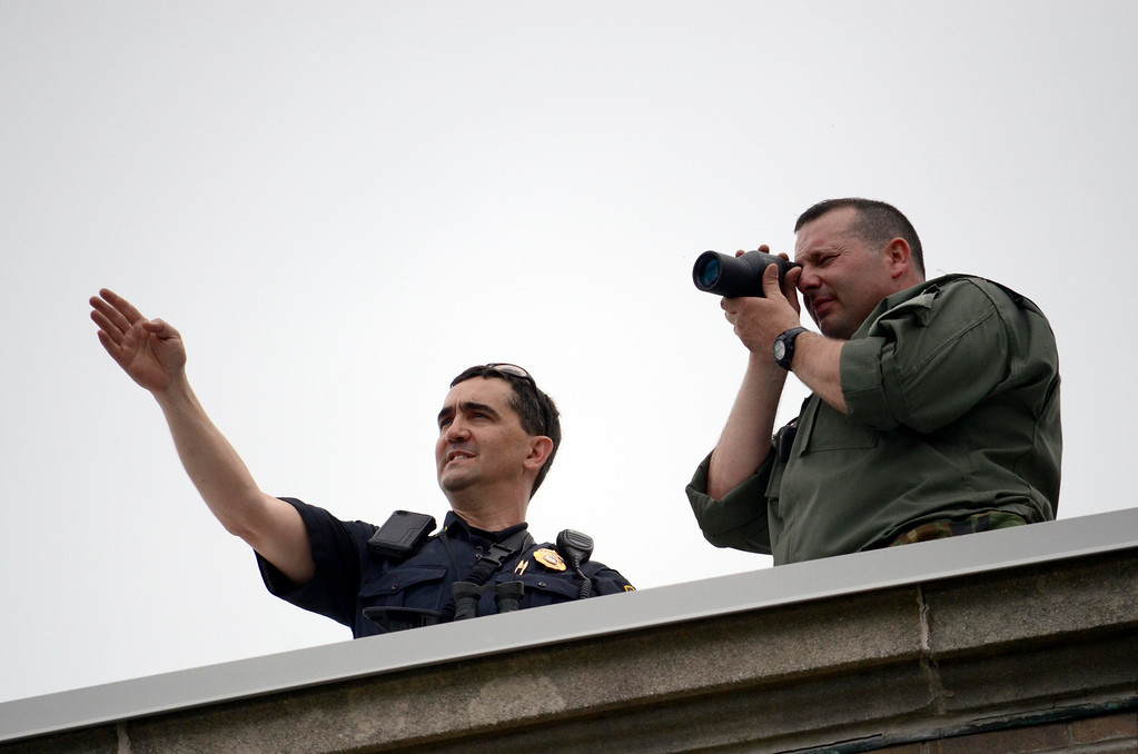 Description of . SRT snipers Sgt Mark Trapani (left, Pittsfield) and Craig DeSantis (Lee) use a courthouse rooftop as a vantage point for security for the pre-trial hearing on the Triple murder case.  Wed May 22, 2013 (GARVER)