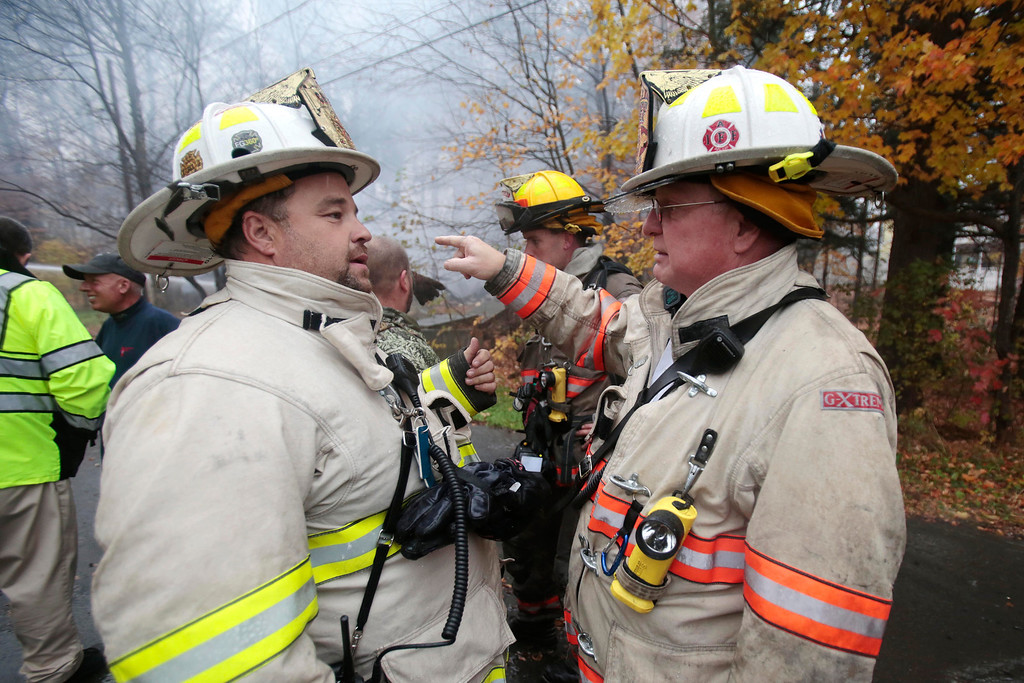 Description of . Lanesborough Fire Chief Charlie Durffe, left, and Pittsfield Fire Chief Robert Czerwinski discuss a fire that leveled a house on National Street in Lanesborough. The house was insulated with foam, making the blaze burn fast. Thursday, October 31, 2013.  (Stephanie Zollshan | Berkshire Eagle Staff)