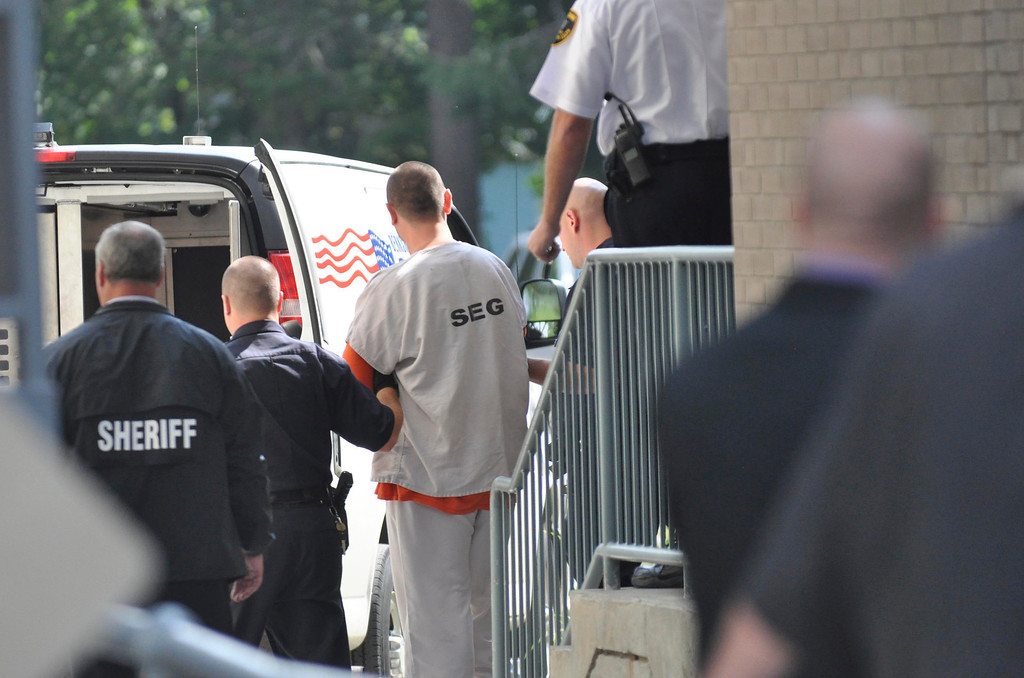 Description of . Adam Lee Hall is led out of Berkshire District Court under very tight security, Mojn Sept 12, 2011.  (GARVER)