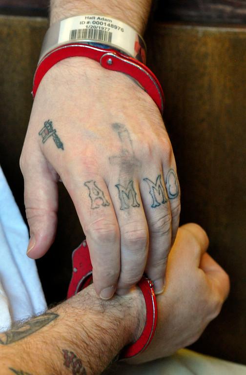 Description of . Adam Lee Hall's hand tatoos.  Wed Sept 12, 2012 (GARVER)