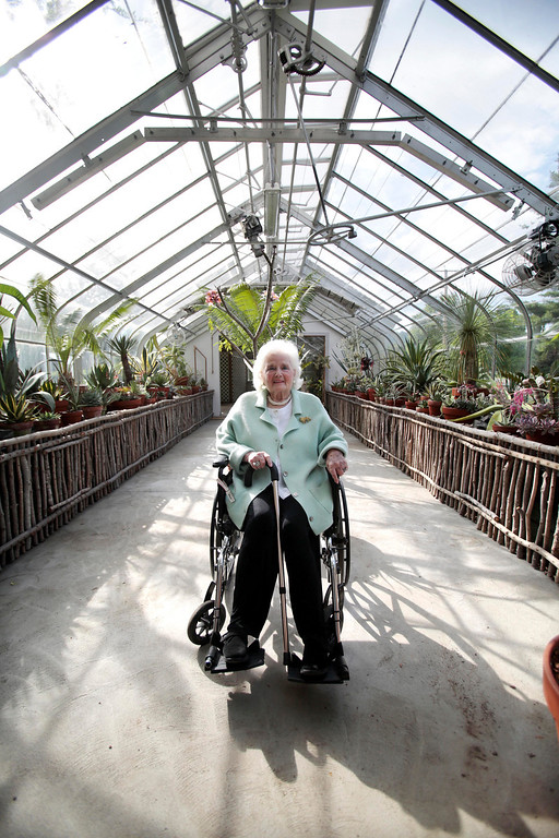 Description of . Jane Fitzpatrick poses for a portrait in the greenhouse that bears her name at a garden party in honor of the dedication of the Berkshire Botanical Garden's newest addition, the Fitzpatrick Greenhouse in Stockbridge. Friday, June 28, 2013. Stephanie Zollshan/Berkshire Eagle.