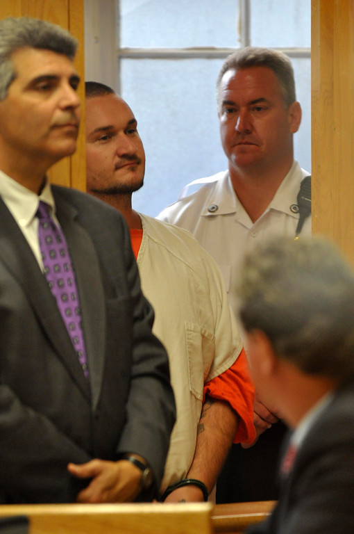 Description of . Adam Lee Hall, 34 , is arraigned in Berkshire District Court on charges of murder and kidnapping of three Pittsfield, Ma men.  Hall was charged with Caius Veiovis and David Chalue after the bodies of David Glasser, Edward Frampton and Robert Chadwell were discovered over the weekend.  Pittsfield, Monday September 12, 2011 (Ap Photo by Ben Garver, The Berkshire Eagle)