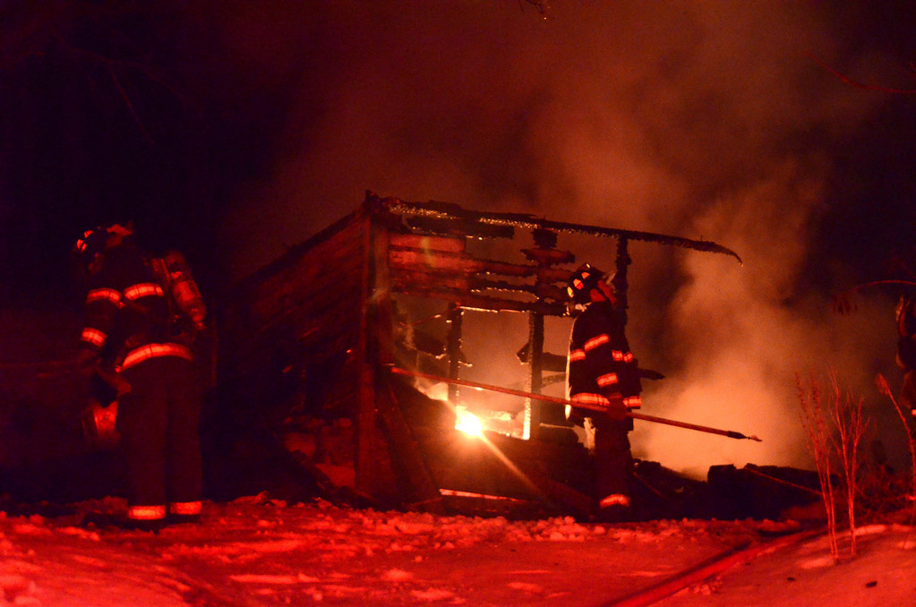 Description of . Firefighters from North Adams contain a structure fire in a shed located directly behind a vacant residence on 45 Edgewood Avenue in North Adams on Saturday, March, 1, 2014 around 8 p.m. The fire, which is under investigation but deemed suspicious, was fueled by a gas tank used for welding. Gillian Jones / Berkshire Eagle Staff / photos.berkshireeagle.com