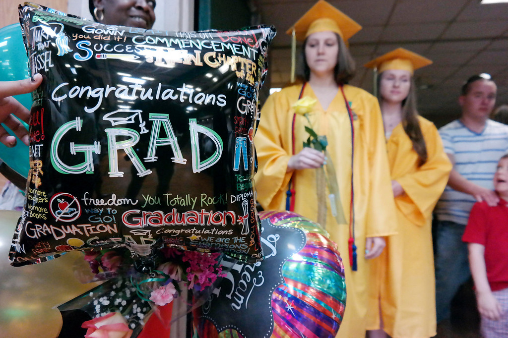 . Taconic High School graduates in Pittsfield prepare to enter the gym for graduation, Sunday June 8, 2014.  Ben Garver / Berkshire Eagle Staff / photos.berkshireeagle.com
