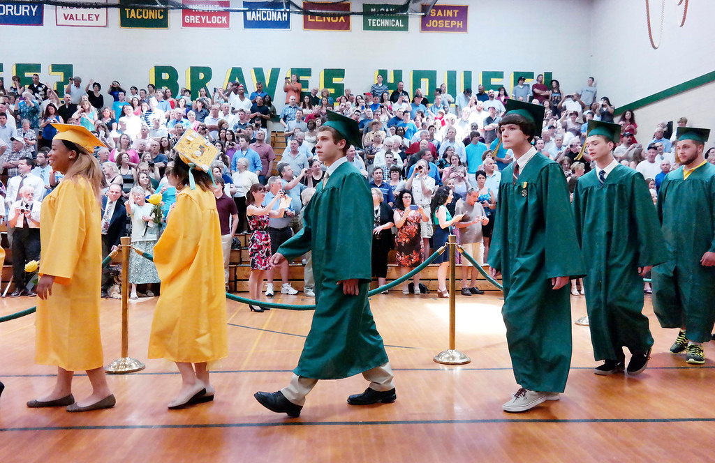 . Taconic High School graduates in Pittsfield  enter the gym for graduation, Sunday June 8, 2014.  Ben Garver / Berkshire Eagle Staff / photos.berkshireeagle.com