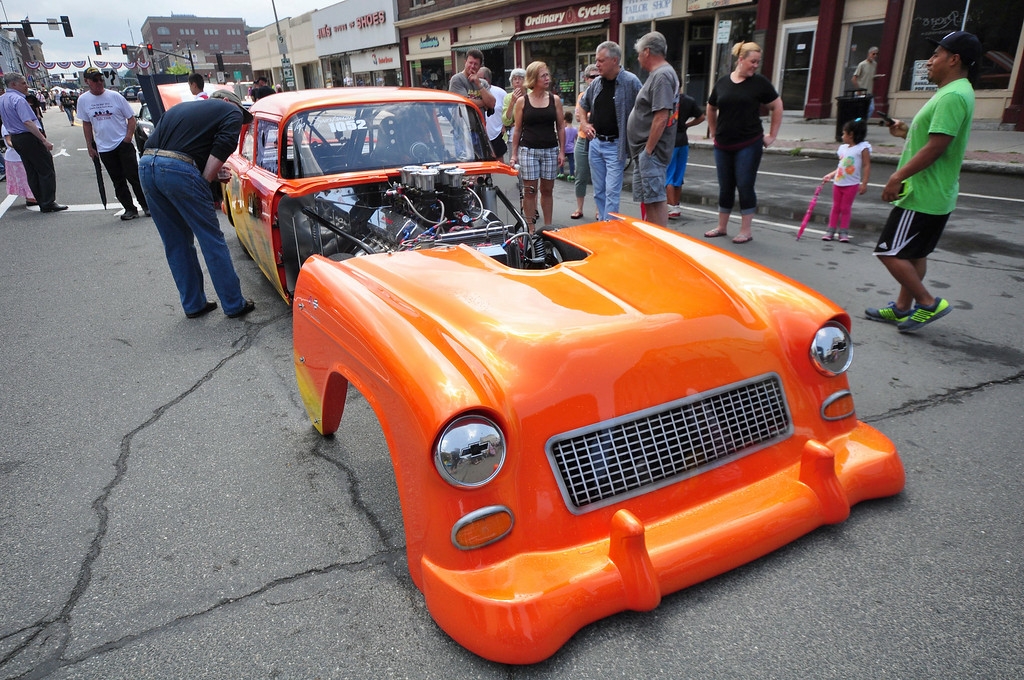 . People look at this 1955 Chevy drag racer, which is owned by Don Lussier of Pittsfield, at the Pittsfield Ethnic Fair and Classic Car Show on North Street in Pittsfield on Sunday, July, 27, 2014. Gillian Jones / Berkshire Eagle Staff / photos.berkshireeagle.com
