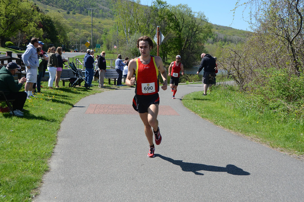 . Mark Rabasco, of Pittsfield, who finished third in the BBC Steel Rail Half Marathon on Sunday, May, 18, 2014, crosses the near half way mark of the race near the intersection of Route 8 in Cheshire near the lake. He is trailed by Chris Plankey who went on to finish second. Gillian Jones / Berkshire Eagle Staff / photos.berkshireeagle.com