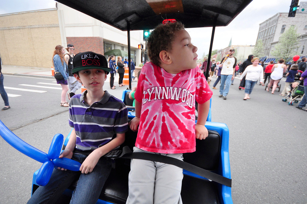 . Casimer Tenczar, 9, of Cheshire, left, and Aiden Kelley, 5, of Pittsfield enjoy a train ride, a new feature this year, up and down North Street, during the first Third Thursday of the season on May 15, 2014. Gillian Jones / Berkshire Eagle Staff / photos.berkshireeagle.com