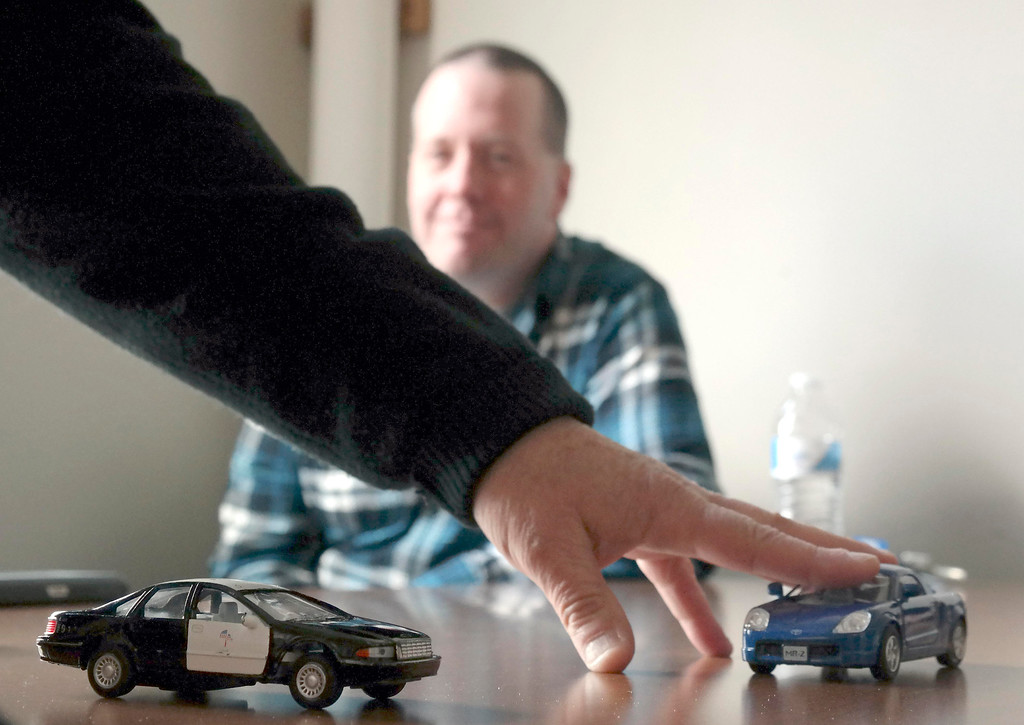 . David Bastion, an emergency vehicle driving insructor, uses a low tech approach to driving scenerios before allowing Williamstown Police officers time on the simulator. Bastien works for MIIA (The Massachusetts Interlocal Insurance Association) Wednesday April 9, 2014.  Ben Garver / Berkshire Eagle Staff / photos.berkshireeagle.com