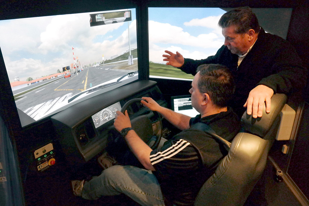 . David Bastion, an emergency vehicle driving insructor, introduces WIlliamstown Police Officer Shuan William to the emergency vehicle driving simulator. Bastien works for MIIA (The Massachusetts Interlocal Insurance Association) Wednesday April 9, 2014.  Ben Garver / Berkshire Eagle Staff / photos.berkshireeagle.com