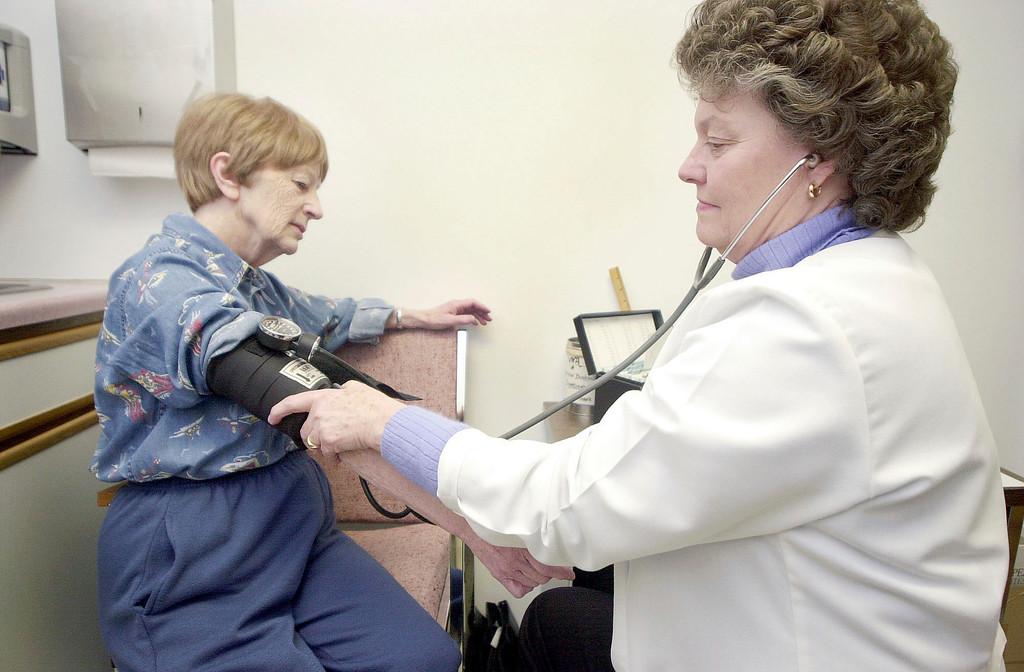 . Cyrilla Krzeminski, left, gets her blood pressure checked by Joyce Kelley R.N. at the VNA & Hospice office in North Adams. Jan. 9 2007 Darren Vanden Berge