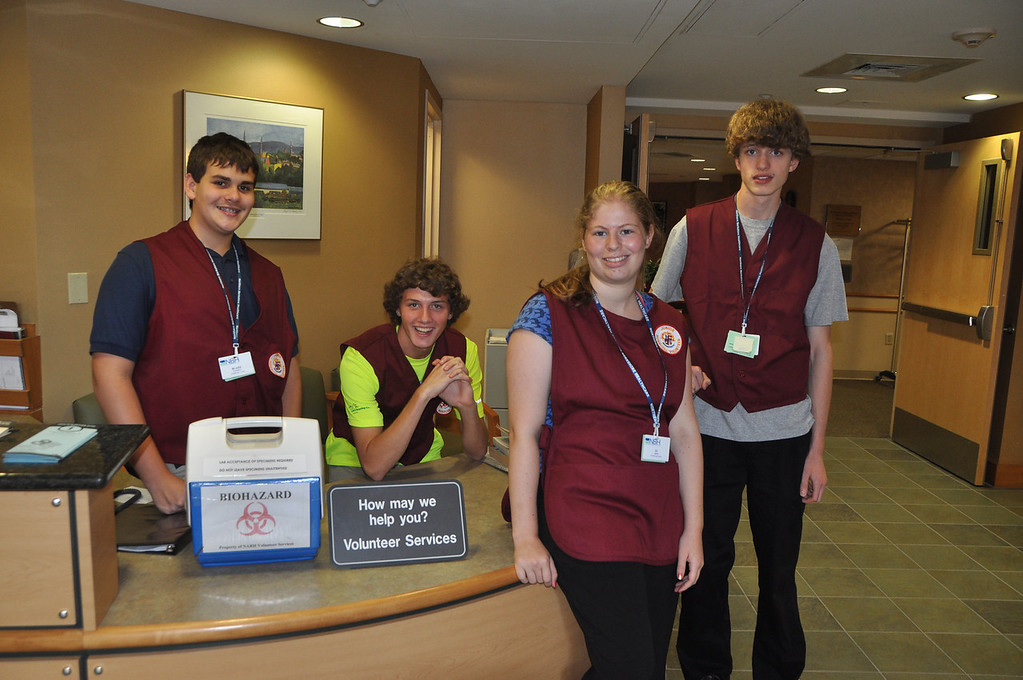 . NARH junior volunteers are from left, Blaize Pandell, 13, Travis Ciempa, 15, DJ Ross, 17, and Andrew Corsi, 15. August 1, 2012. File photo by Gillian Jones