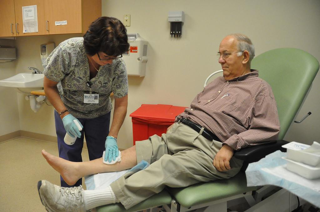 . Robin Lemay has been treating Michael Tassone in the Wound Care Unit at North Adams Regional Hospital.  December, 4, 2010. File photo by Gillian Jones