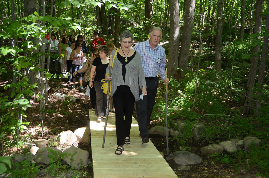 . Northern Berkshire Healthcare President Tim Jones and Ellen Bernstein, a member of the Board of Trustees, walk on the path created on hospital grounds with a donation from Bernstein on Friday August 16, 2013. (Gillian Jones/North Adams Transcript file)