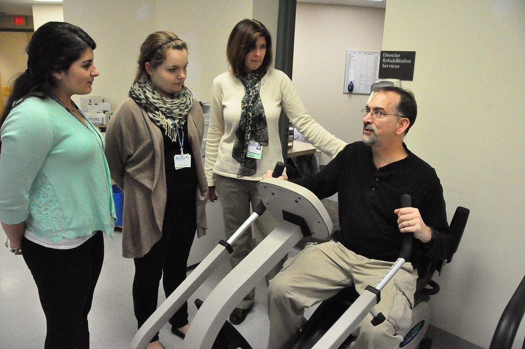 . As part of Job Shadow day these Drury High School students spent the day in Rehabilitative Services at North Adams Regional Hospital. From left, students Katie Cirullo, 16, and Monica Thomas, 15, watch as Valerie Nichols, an occupational therapist works with Craig Lawson.  February, 2, 2013. File photo by Gillian Jones