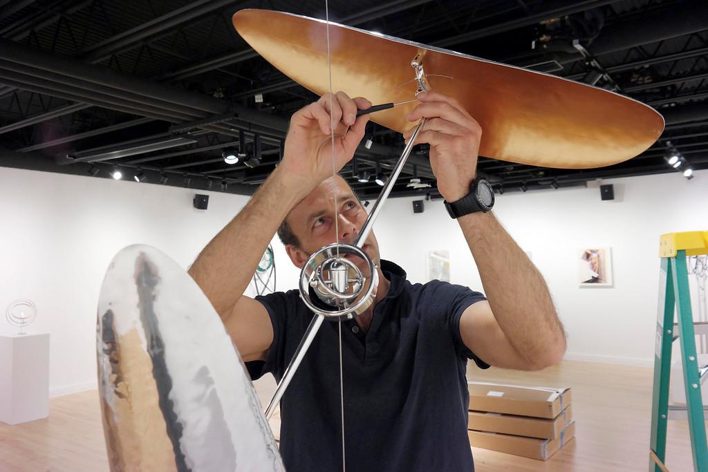 . Sculptor Pedro S. de Movellian installs his kinetic sculpture at the Berkshire School\'s Fine Arts Center in Scheffield. Wednesday May 7, 2014.  Ben Garver / Berkshire Eagle Staff / photos.berkshireeagle.com
