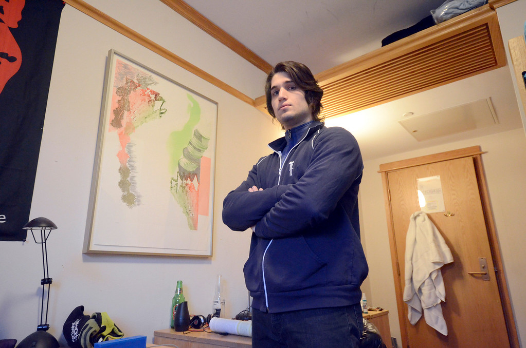 . As part of the Williams College Museum of Arts\'s WALLS, Williams Art Loan for Living Spaces, freshman Sam Steakley has the print \'Rake\' by Pia Fries in his dormitory room at Sage Hall. Gillian Jones / Berkshire Eagle Staff / photos.berkshireeagle.com