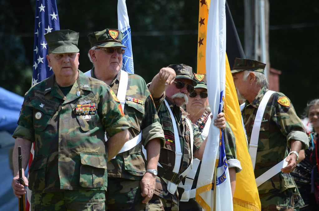 . The The 65th Chapter of the Vietnam Veterans of Pittsfield led the grand entry of participants into the Rock Rattle and Drum Pow Wow in Adams, Sunday Aug 10, 2014.  Ben Garver / Berkshire Eagle Staff / photos.berkshireeagle.com