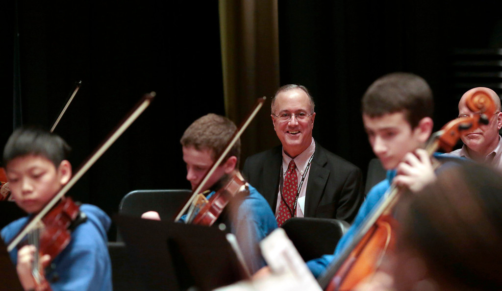. Mayor Daniel Bianchi watches as Herberg Middle School student musicians play before six of them receive musical instruments from the Domenic A. Izzi Jr. Foundation for Young Aspiring Musicians. Thursday, April 3, 2014. Stephanie Zollshan / Berkshire Eagle Staff / photos.berkshireeagle.com