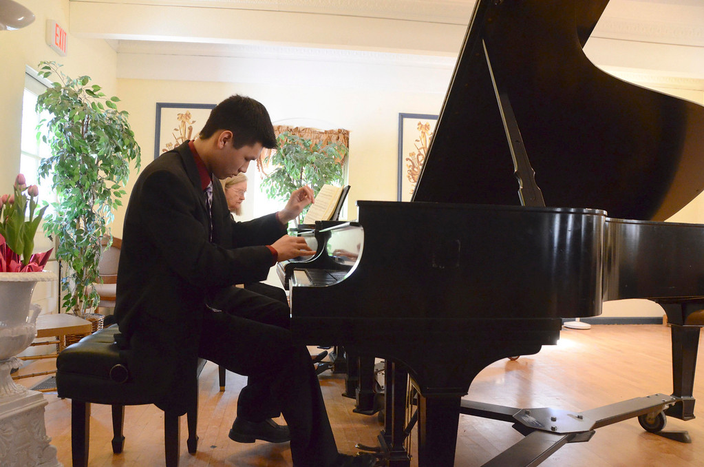 . The Berkshire Music School in Pittsfield held a music marathon weekend on Saturday and Sunday. Yee Jin Yuk, 16, of Hillsdale, NY and his teacher Jean Stackhouse play pianos side by side on Sunday, April, 6, 2014. Gillian Jones / Berkshire Eagle Staff / photos.berkshireeagle.com