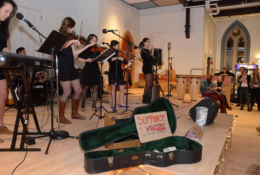 . Wiliams College students in Andy Kelly\'s music class performed in Goodrich Hall on Monday, January, 27, 2014, to raise money to help buy musical instruments for students at Crosby Elementary School in Pittsfield. The band \'Destiny\'s Cousin\' performs. Gillian Jones/Berkshire Eagle Staff