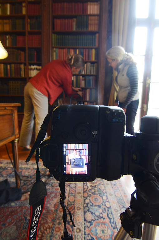 . Books in the Edith Wharton Library are arranged to compliment a Dooney and Bourke handbag during a photo shoot, Monday September 23, 2013. Ben Garver / Berkshire Eagle Staff