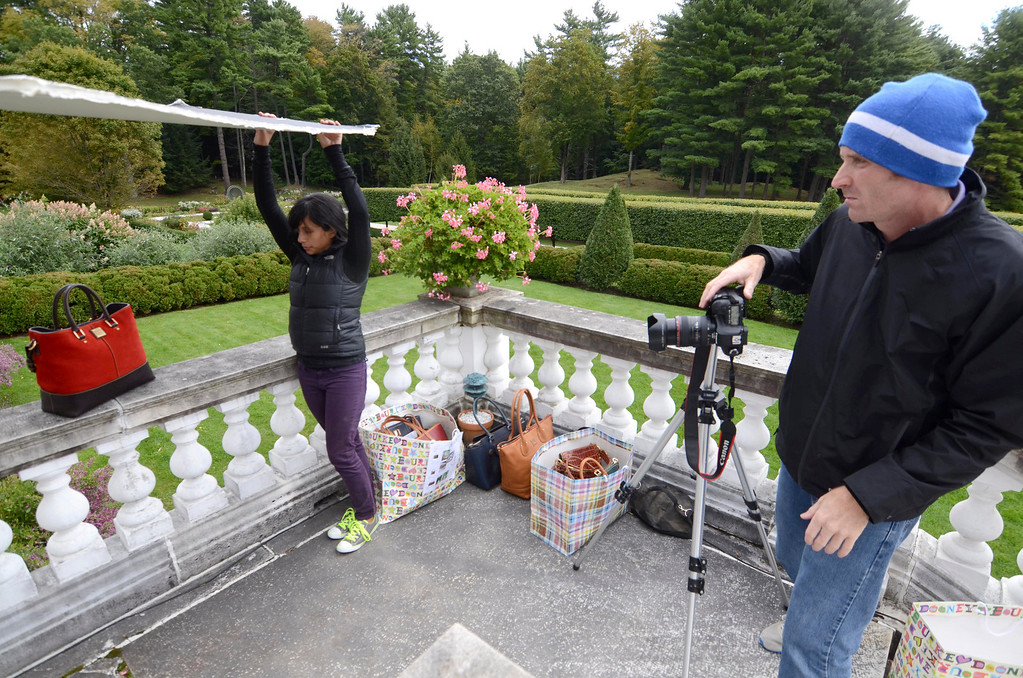 . Photographer Mike Altobello and assistant Payal Parikh photograph Dooney and Bourke handbags at the Mount, Monday September 22, 2013.  Ben Garver / Berkshire Eagle Staff