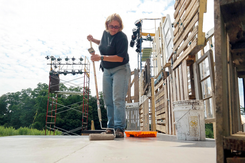 . Maia Robbins-Zust paints the stage for the set of a Midsummer Night\'s Deam at Springside Park in Pittsfield for Shakespeare in the Park. Monday July 14, 2014. Ben Garver / Berkshire Eagle Staff / photos.berkshireeagle.com