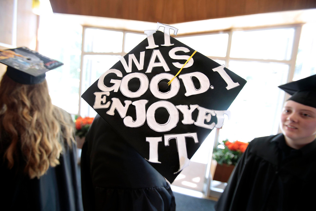 . Michael Perkins sports the phrase that was his motto throughout his senior year: \'It was good, I enjoyed it,\' atop his mortar board during the BART charter high school graduation at MCLA in North Adams. Saturday, June 7, 2014. Stephanie Zollshan / Berkshire Eagle Staff / photos.berkshireeagle.com