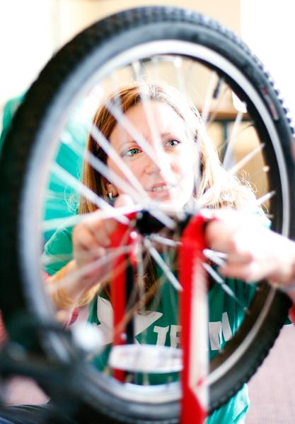 Berkshire Bank volunteers build bikes for local children-111815