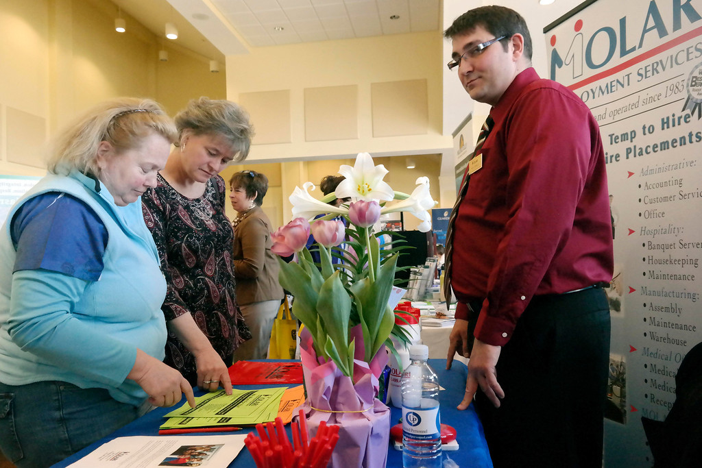 . Former NARH RNs Angie Ligner  and Robbin Simonetti look at job oportunities at the 2014 Berkshire Career Fair, Thursday April 10, 2014.  Nick Costello is on the right of the frame from Molari Employment. Ben Garver/ Berkshire Eagle Staff / photos.berkshireeagle.com