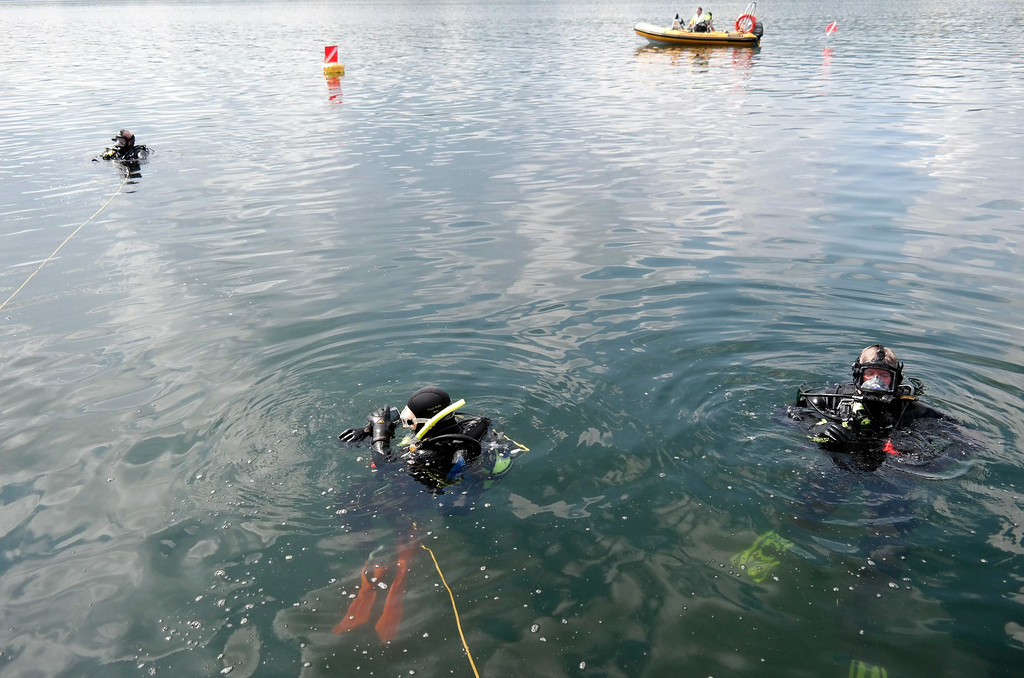 . Members of the Berkshire County Sheriff department dive team  search for a discarded handgun in Onota Lake, Wednesday Aug 20, 2014. The handgun in question was thrown in the lake after a man decided not to use it to take his own life three years ago. Ben Garver / Berkshire Eagle Staff / photos.berkshireeagle.com
