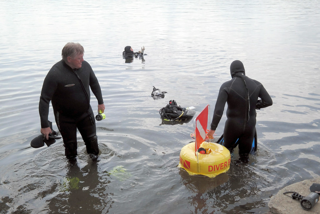 . Members of the Berkshire County Sheriff department dive team prepare to search for a discarded handgun in Onota Lake, Wednesday Aug 20, 2014.  The handgun in question was thrown in the lake after a man decided not to use it to take his own life three years ago. Ben Garver / Berkshire Eagle Staff / photos.berkshireeagle.com