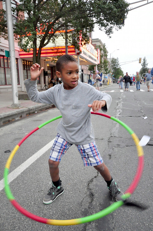 . Kaalig Chappelle, 6, hula hoops with a Shire dance hoop on North Street during Third Thursday on August 21, 2014. Gillian Jones/ Berkshire Eagle Staff / photos.berkshireeagle.com