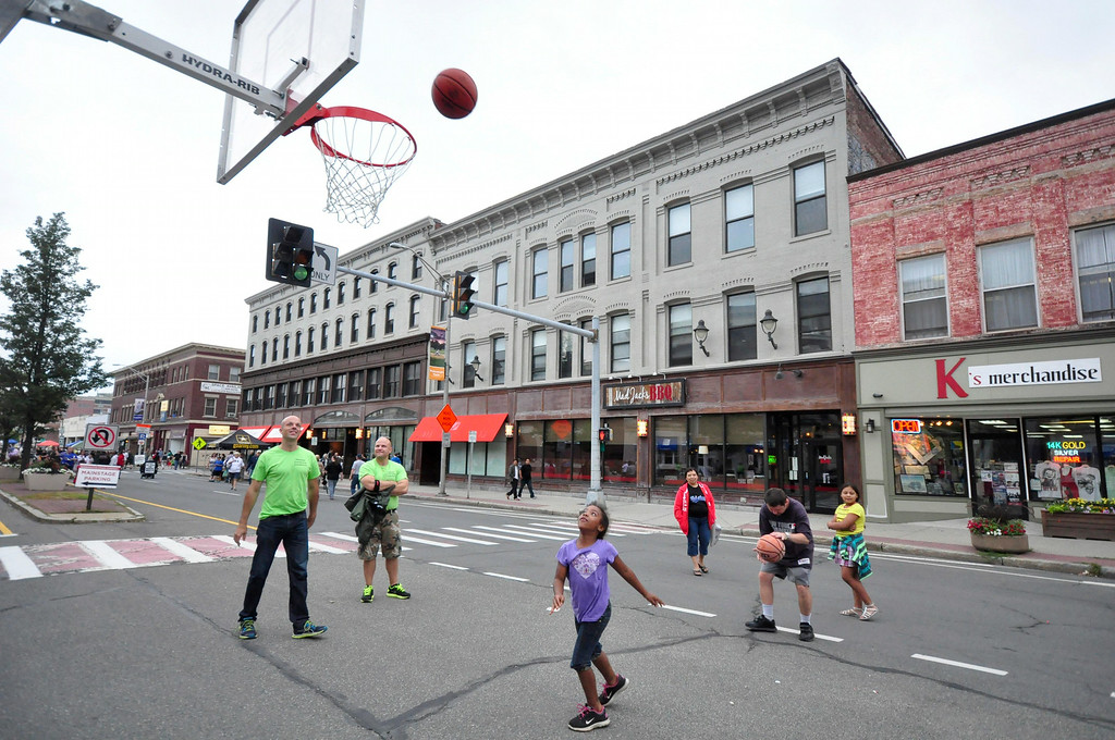 . Kids enjoy shooting hoops courtesy of the Pittsfield Community Connection on North Street during Third Thursday on August 21, 2014. Gillian Jones/ Berkshire Eagle Staff / photos.berkshireeagle.com