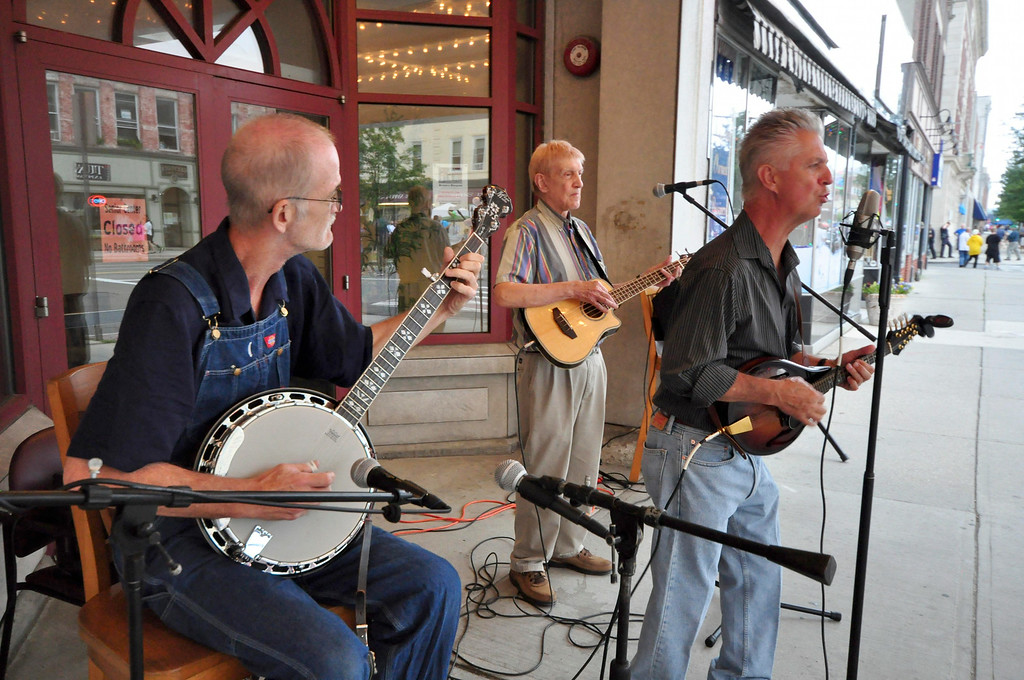 . From left, Chris Scott, Steve Dudziak and Woody Printz of Berkshire Bluegrass play on North Street during Third Thursday on August 21, 2014. Gillian Jones/ Berkshire Eagle Staff / photos.berkshireeagle.com