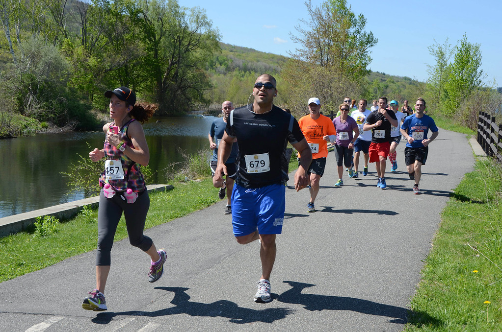 . Runners finish the near half way mark as they approach the Route 8 intersection near Cheshire Lake on the Ashuwillticook Trail for the BBC Steel Rail Half Marathon on Sunday, May, 18, 2014. Gillian Jones / Berkshire Eagle Staff / photos.berkshireeagle.com