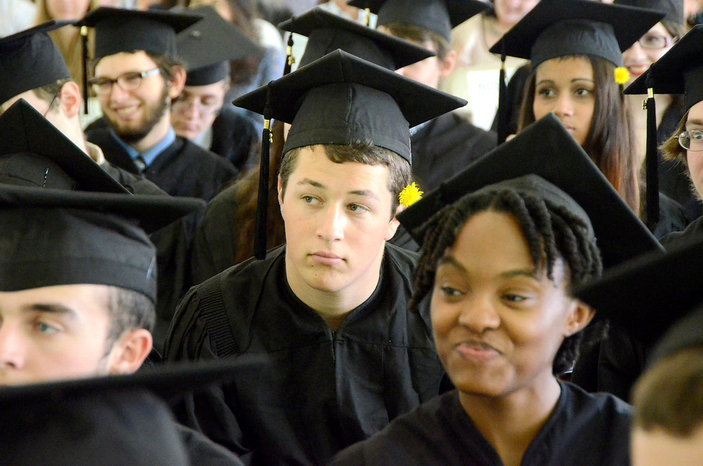. Kai Hillel Naor of Clinton Corners, NY listens to class speaker Pearl Carmer Weggler during Commencement Exercises at Simon\'s Rock of Bard College on Monday, May, 26, 2014. Gillian Jones / Berkshire Eagle Staff / photos.berkshireeagle.com