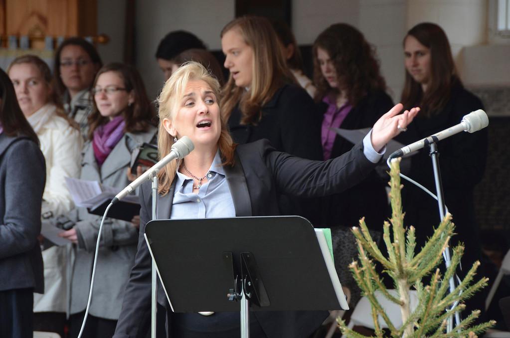 . Mary Verdi, a Berkshire singer/songwriter, leads the chorus in song during the Divine Mercy Sunday Solemn Liturgy on Sunday, April, 27, 2014 in Stockbridge. Gillian Jones / Berkshire Eagle Staff / photos.berkshireeagle.com