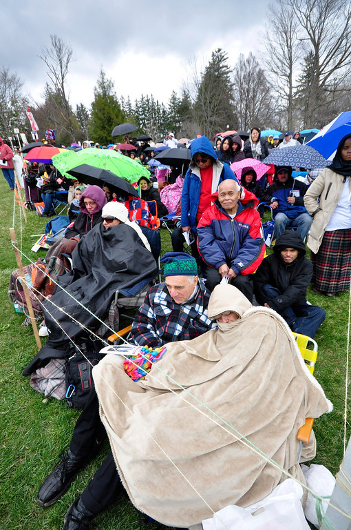 . Thousands brave the rain and chilly weather to attend the Divine Mercy Sunday Solemn Liturgy on Sunday, April, 27, 2014 in Stockbridge. Gillian Jones / Berkshire Eagle Staff / photos.berkshireeagle.com