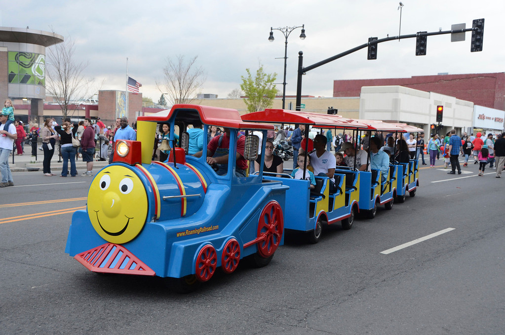 . Children and their parents ride the choo choo train down North Street during the first Third Thursday of the season on May 15, 2014.  The train which costs $3 per person to ride is new this year. Gillian Jones / Berkshire Eagle Staff / photos.berkshireeagle.com