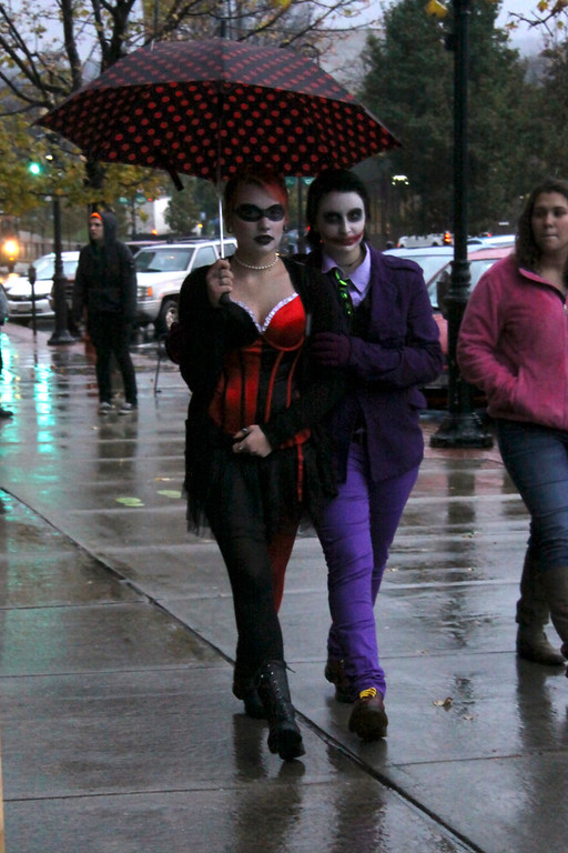 ". Bridget Tangway and Jessie Rosentuig, of North Adams, walk down Main Street on Halloween evening during the DownStreet Art ""Fright Night\"" on Thursday, Oct. 31, 2013 (Holly Pelczynski/Berkshire Eagle Staff)"
