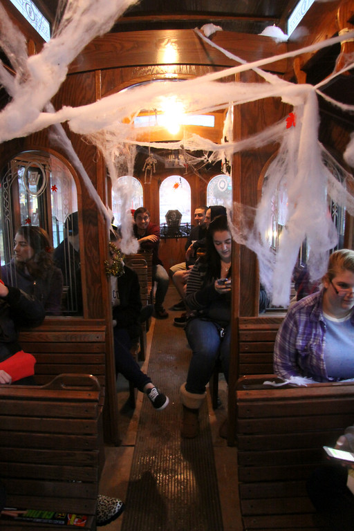 ". MCLA Students take a ride on  the ""Haunted Trolley\""  during DownStreet Arts\' Fright Night on Thursday, Oct. 31, 2013. (Holly Pelczynski/Berkshire Eagle Staff)"