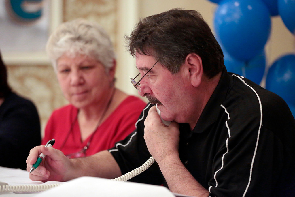 . Jim Disimoni answers donation calls at the United Cerebral Palsy of the Berkshires telethon at the Crowne Plaza in Pittsfield. Sunday, January 26, 2014. (Stephanie Zollshan | Berkshire Eagle Staff)