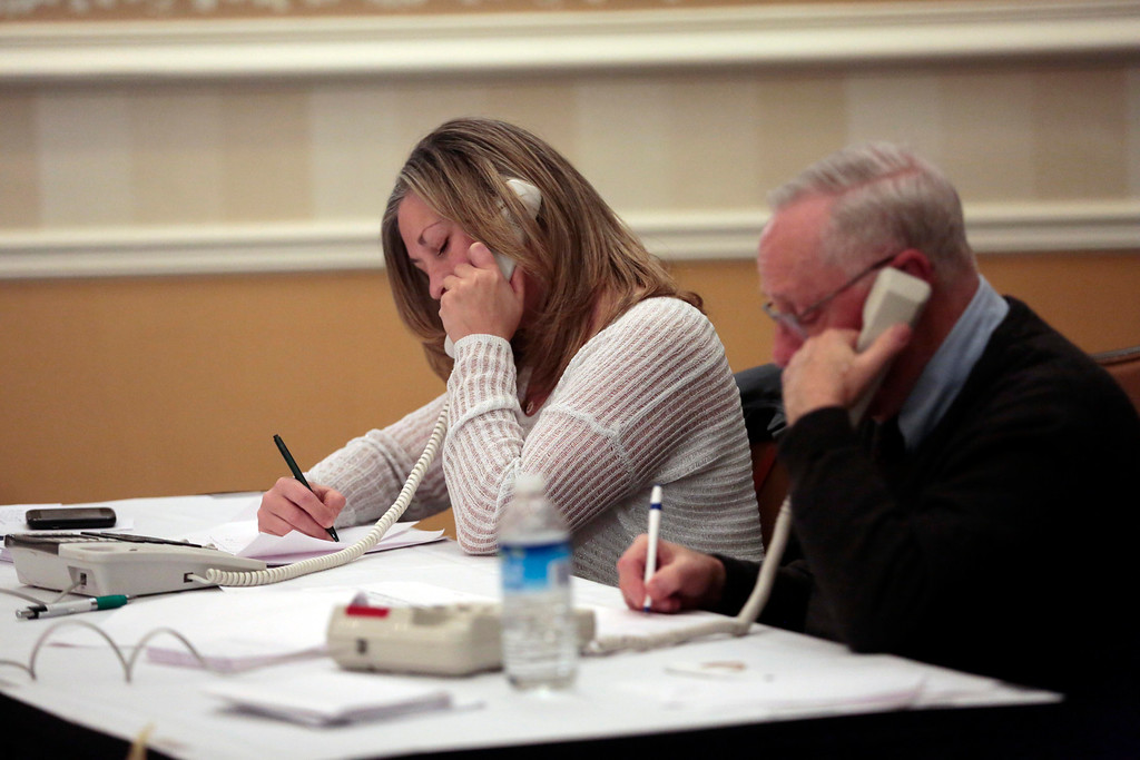 . Cathy Mazzeo and Ray Ferrarin answer donation calls at the United Cerebral Palsy of the Berkshires telethon at the Crowne Plaza in Pittsfield. Sunday, January 26, 2014. (Stephanie Zollshan | Berkshire Eagle Staff)