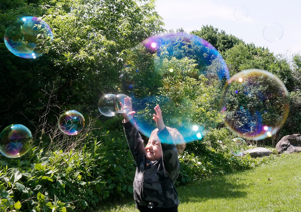 . Seth Laprade, age 2, chased bubbles at Rotary Park in Pittsfield as part of the Springside Park Get Outdoors Day. Saturday June 14, 2014.  Ben Garver / Berkshire Eagle Staff / Photos.berkshireeagle.com