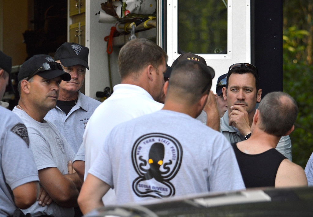 . Massachusetts and New York State Police divers prepare to search Greenwater Lake in Becket for clues related to the alleged abduction of James Lusher by Lewis Lent, Tuesday July 16, 2013. Ben Garver / Berkshire Eagle Staff