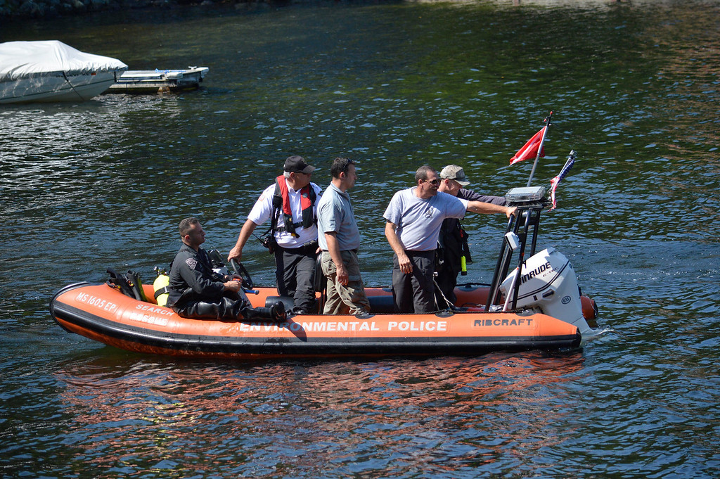 . Police from Massachusetts search  for clues related to the alleged abduction of James Lusher by Lewis Lent, Tuesday July 16, 2013. Ben Garver / Berkshire Eagle Staff