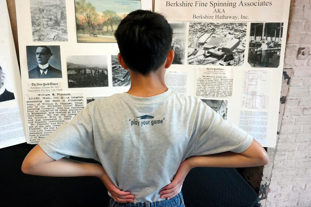 ". Joshua Kunzmann, 13, studies the history of the Berkshire Mills at \""The Mill Children\"" exhibit. Wednesday Aug. 6, 2014. Ben Garver / Berkshire Eagle Staff / photos.berkshireeagle.com"